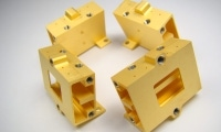 Gold plated parts machined with a variety of wire EDM, small hole EDM, and CNC milling techniques.
