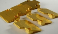Several gold plated, and most importantly, scratch-free aluminum parts.