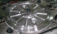 A stainless steel diameter speckled with coolant immediately following CNC machining.