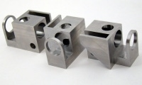 Even though these parts don't require simultaneous 5-axis milling, additional setups were avoided with 3+2 machining.