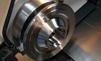 Although this 2-foot diameter part entered the machine as a casting, CNC turning services have given it a precision finish.