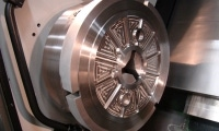 A stainless steel part more than 20 inches in diameter waits just after finishing machining.