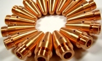 The threaded hole on the top of these copper parts were produced by a lathe with live tooling.