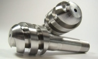 These 304 stainless steel parts have a spiral thread that was CNC turned on the outside diameter.