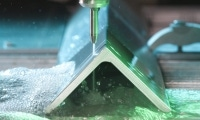 Cutting stream slices through angled extrusion. Photo courtesy of Flow International.
