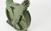 Waterjet can cut virtually any design from virtually any material, including this eagle cut from marbled foam.
