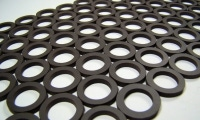 Magnetic washers cut via waterjet before the magnetizing process.