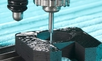 Waterjet stream holds precision tolerances on plastic over 1 inch thick. Photo courtesy of Flow International.