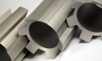 Several steel cores wire EDM cut after a CNC turning operation.